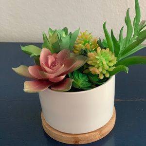 Fake succulent arrangement in ceramic planter